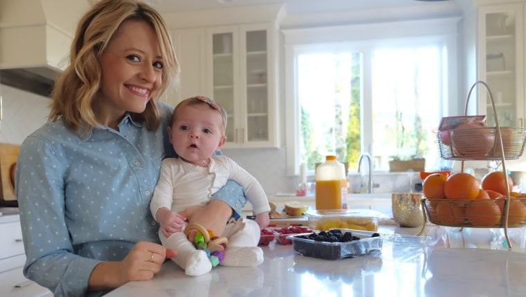 Kelsey Nixon holding her daughter Nora