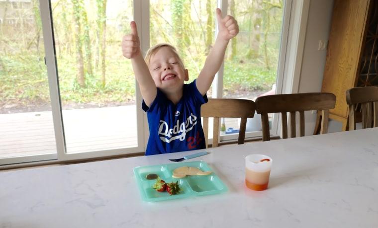 Kelsey Nixon's son Ollie enjoying his breakfast