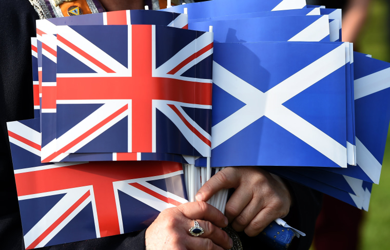 Image: The Union flag of the U.K. and the Saltire flag of Scotland.