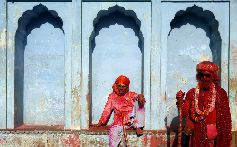 Image: Hindu devotees take part in the religious festival of Holi in Nandgaon