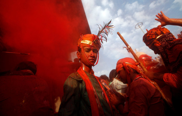 Image: Hindu devotees take part in the religious festival of Holi in Nandgaon village