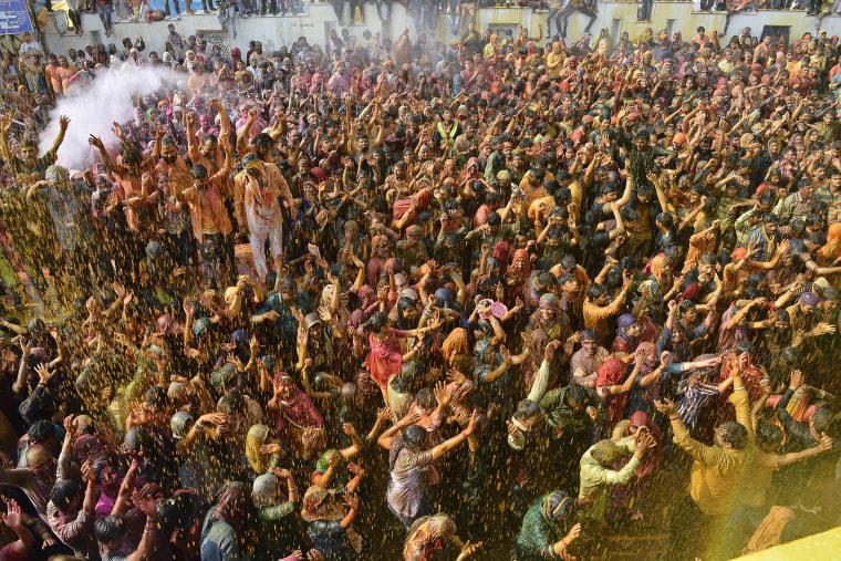 Image: Indian Hindu devotees celebrate Holi