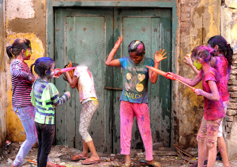 Image: Indian revellers play with colours during Holi celebrations