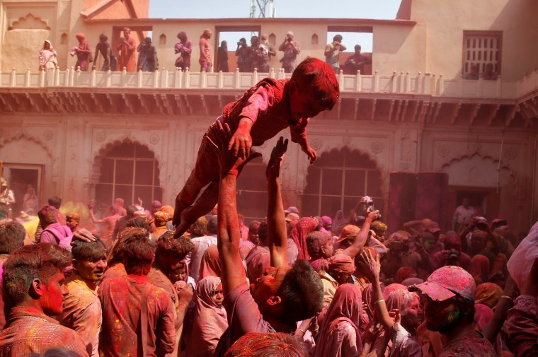 Image: People take part in Holi celebrations in the town of Vrindavan in the northern state of Uttar Pradesh