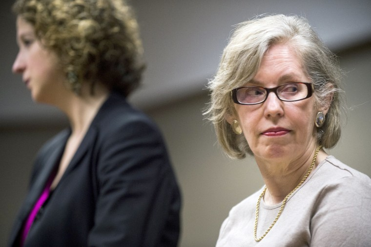 Image: Corinne Miller, right, retired director of the state Department of Health and Human Services' Bureau of Epidemiology, is sentenced to probation, March 13, 2017.