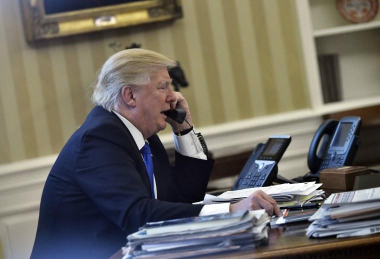 Image: Donald Trump speaks on phone with Angela Merkel on Jan. 28, 2017