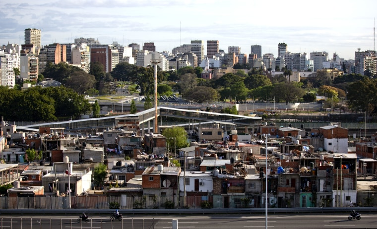 This Oct. 4, 2016 photo shows the Villa 31 neighborhood, backdropped by downtown, as well as middle class apartments and office buildings in Buenos Aires, Argentina.