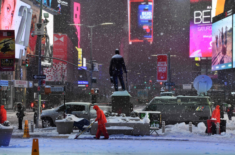 Image: Men plow snow in Times Square