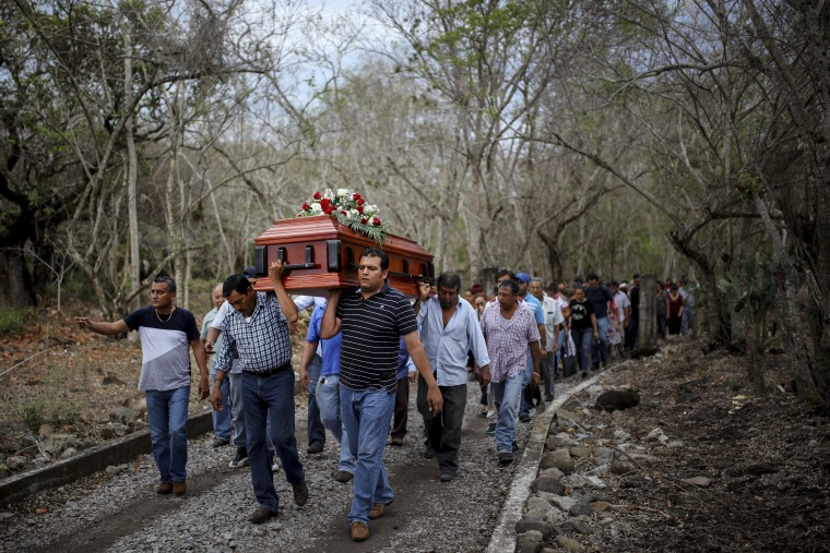 In this March 8, 2017 photo, members of the Solecito search group carry the coffin of Pedro Huesca, a police detective who disappeared in 2013 and was recently found in a mass grave, to the cemetery in Palmas de Abajo, Veracruz, Mexico. Huesca's remains are among more than 250 skulls found over the last several months.