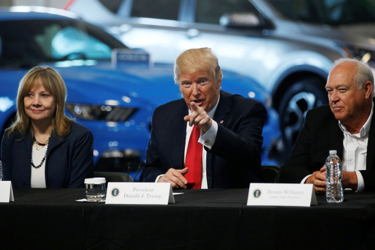Image: Trump talks with auto industry leaders, including Barra and Williams at the American Center for Mobility in Ypsilanti Township