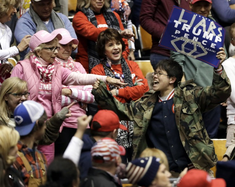 Image: A protester yells during a speech by President Donald Trump at a rally