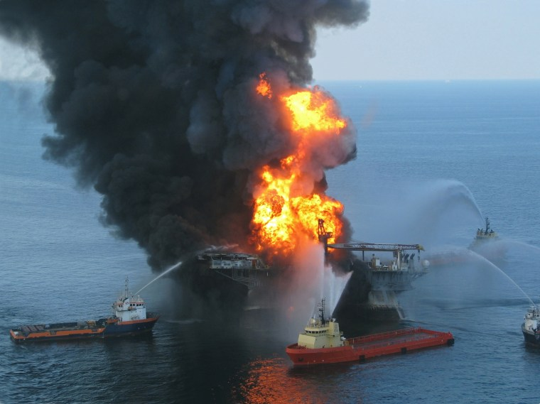 Coast guard platform supply vessels fight the fire of the Deepwater Horizon oil rig explosion.