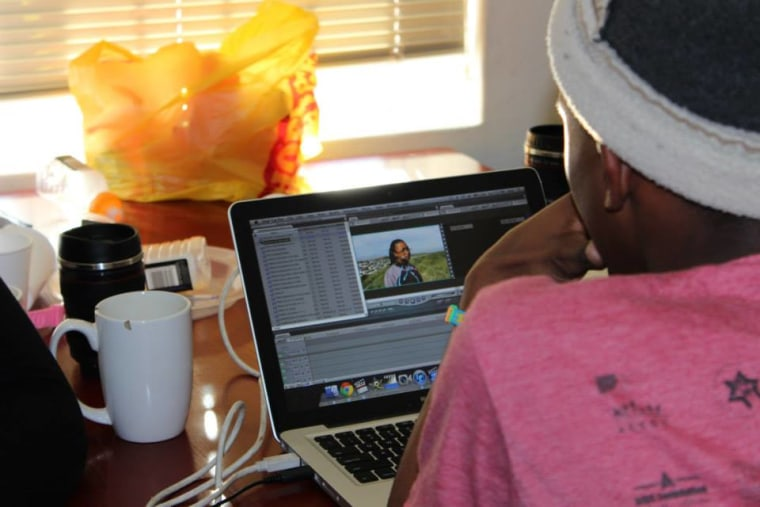An Equal Education activist editing their short documentary