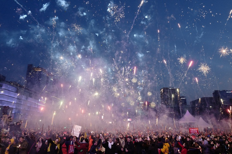 Image: South Koreans gather to celebrate after the court's ruling  on the impeachment of South Korean President Park