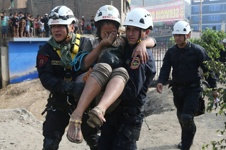 Image: A woman is rescued, March 17.