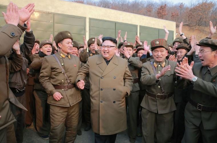 Image: Kim Jong-Un (center) inspects the ground jet test of a newly developed high-thrust engine
