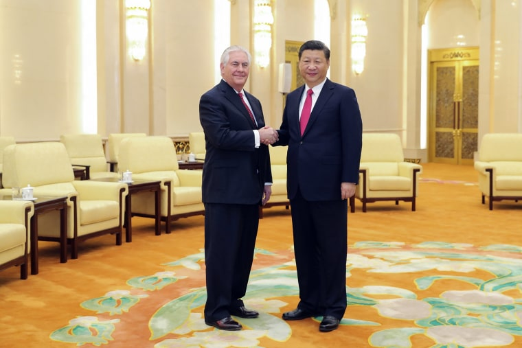 Image: State of Secretary Rex Tillerson shakes hands with China's President Xi Jinping