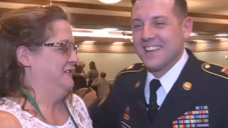 Big smiles: Penny and Dustin Pearson are reunited at her nursing school graduation after his nearly yearlong Army deployment.
