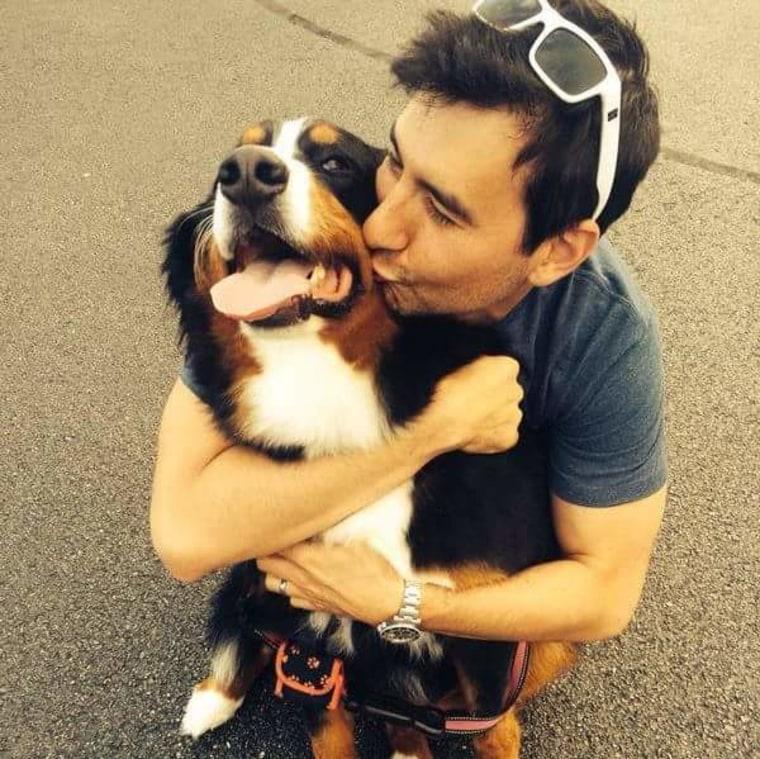 Christopher Vrankovic hugs his dog, Lucy