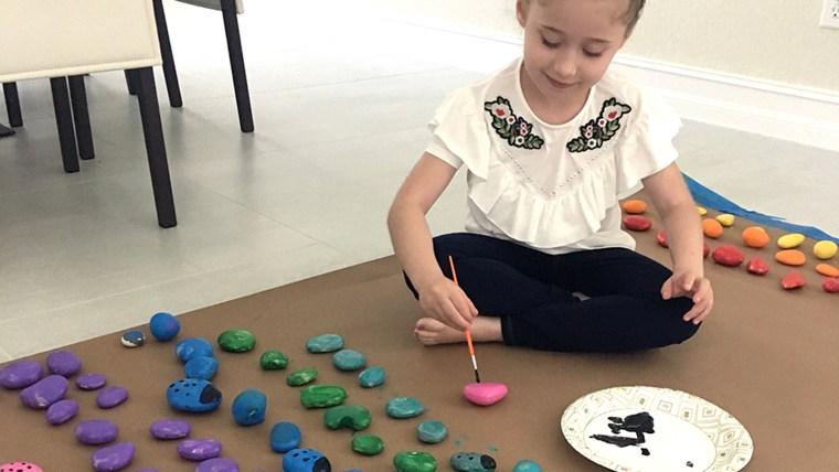Girl paints rocks to adorn desecrated Jewish tombstones