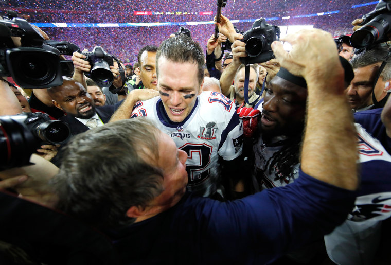 Super Bowl LI - Head coach Bill Belichick, Tom Brady #12 and LeGarrette Blount #29 of the New England Patriots celebrate