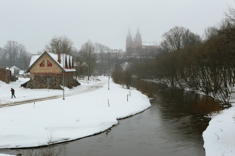 Image: A view on the river and a church in Rezekne, Latvia