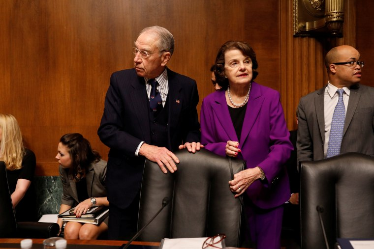 Image: Committee Chairman Sen. Chuck Grassley (R-IA) and Ranking Member Sen. Dianne Feinstein (D-CA) arrive for a hearing for Rod Rosenstein, nominee to be Deputy Attorney General, before the Senate Judiciary Committee