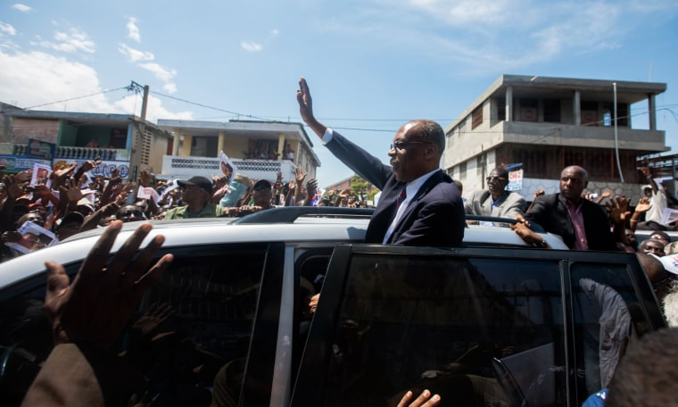Image: Former Haitian President Jean-Bertrand Aristide greets supporters