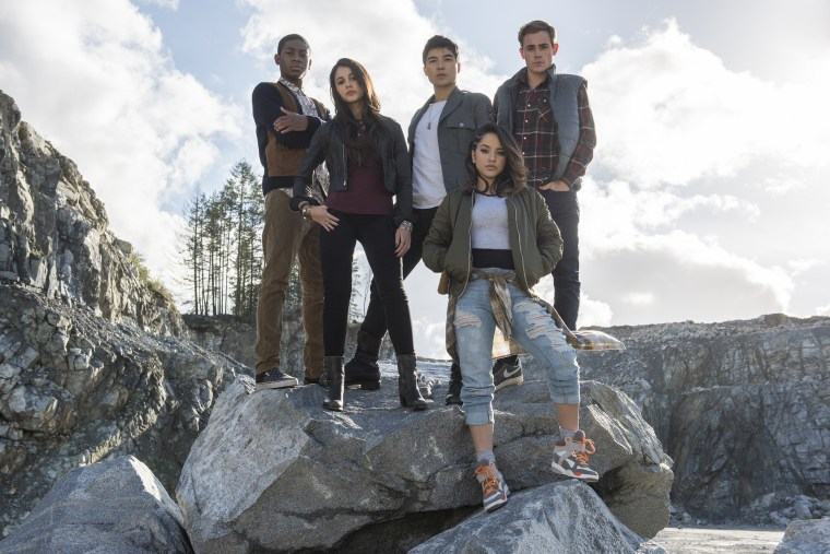 "From left to right: Billy the Blue Ranger (RJ Cyler), Kimberly the Pink Ranger (Naomi Scott), Zack the Black Ranger (Ludi Lin), Trini the Yellow Ranger (Becky G) and Jason the Red Ranger (Dacre Montgomery) in ""Power Rangers."""