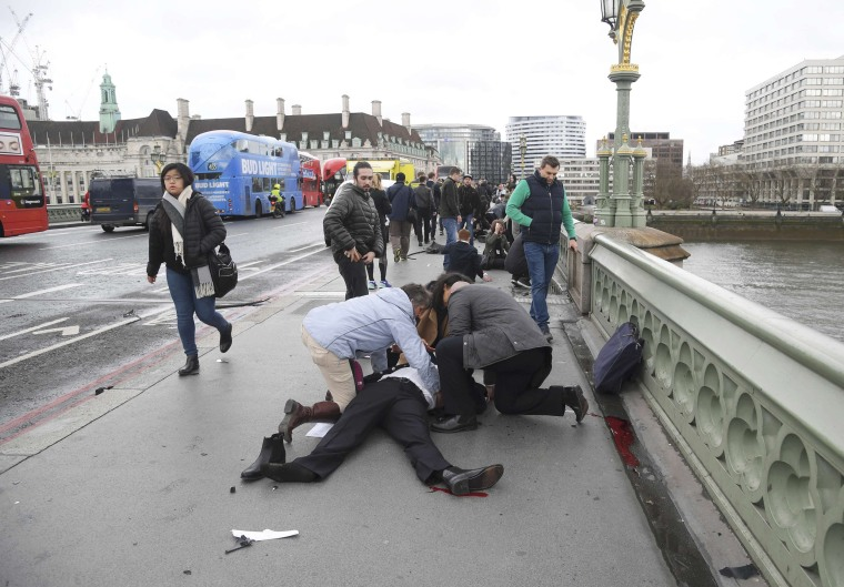 Image: Injured people are assisted after an incident on Westminster Bridge in London