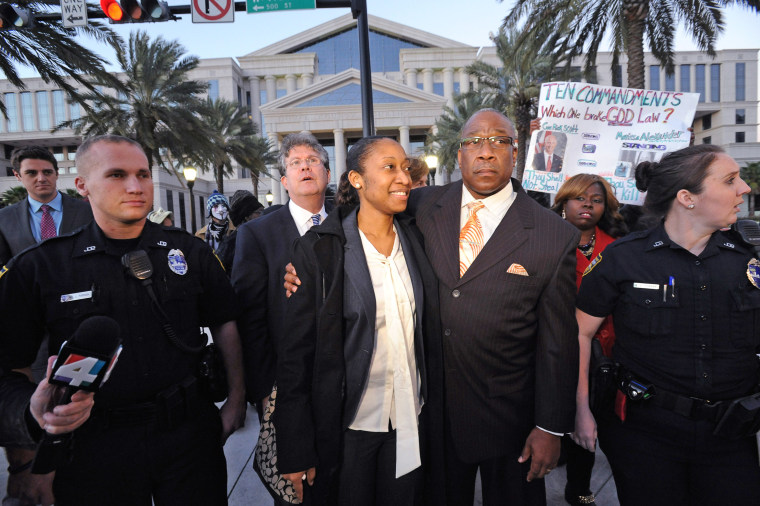 Marissa Alexander walks with her dad Raoul Jenkins after her sentencing in Jacksonville on Jan. 27, 2015.
