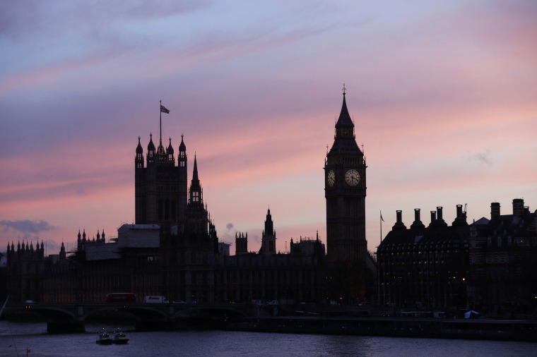 Image: The sun sets behind the Houses of Parliament after an attack on Westminster Bridge in London