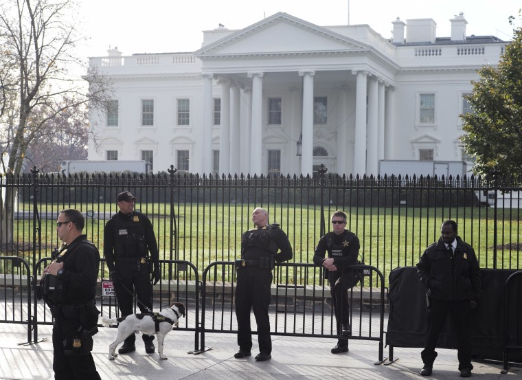 Image: Secret Service agents patrol in front of the White House