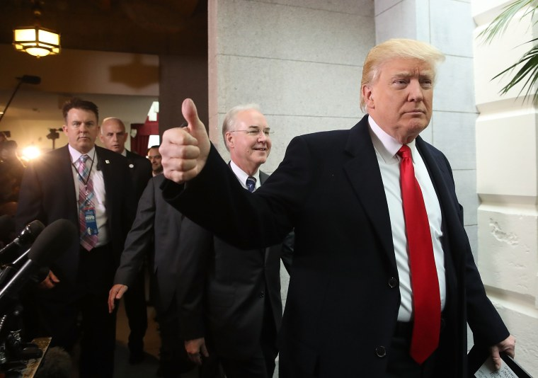 Image: President Donald Trump gives a thumbs up alongside and Health and Human Services Secretary Tom Price