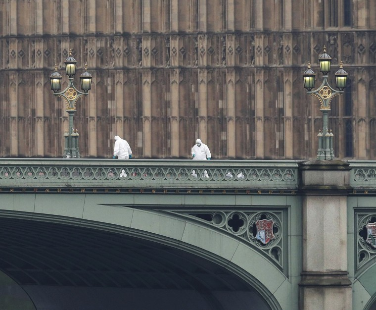 Image: Police officers and forensics investigators and police officers work on Westminster Bridge