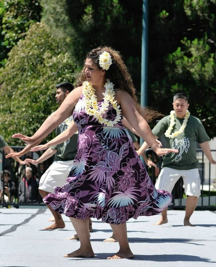 Marlo Lualemana performing the hula.