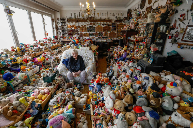 Image: Belgian Catherine Bloemen, 86, sits among more than 20,000 stuffed and plastic toys, she is collecting for more than 65 years, in her house in Brussels