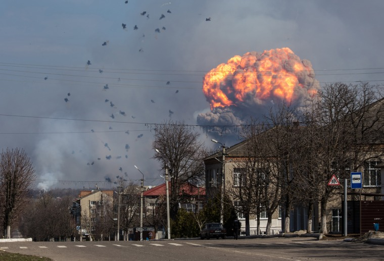 Image: A huge cloud of smoke with fire billowing from the site of an ammunition depot of the Ukrainian Armed Forces, near the city of Balakiya, Kharkiv area, Ukraine
