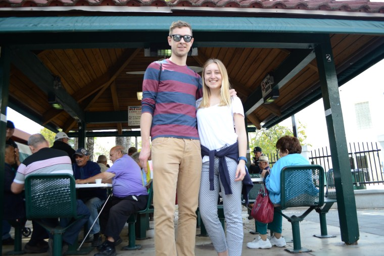 Laura Neufert and Johannes Fuehner, a couple from Germany on vacation in Miami, spent a day in the Little Havana neighborhood. They are pictured here in front of Maximo Gomez Park, also known as Domino Park on 3/17/17.