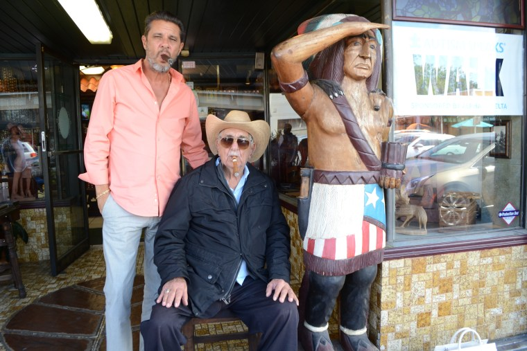 Don Pedro Bello and his son, Peter Bello, outside their business - Cuba Tobacco Cigar Co in Little Havana; the business started in Las Villas in Cuba over 100 years ago.