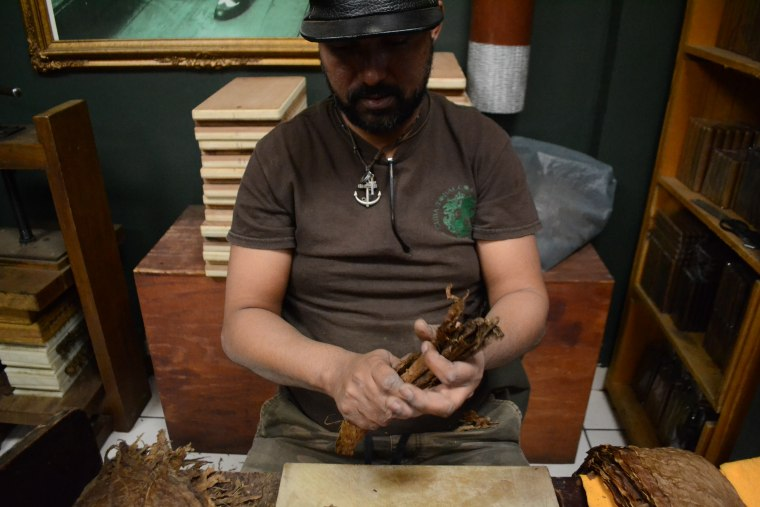 Inside Cuba Tobacco Cigar Co in Little Havana, cigars are hand rolled by Cuban cigar makers.