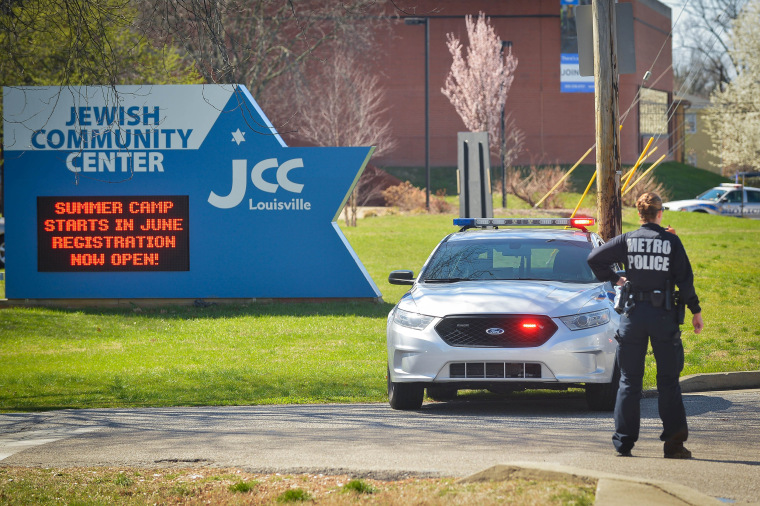 Image: A police officer blocks an entrance as officials respond to a bomb threat at the Jewish Community Center in Louisville