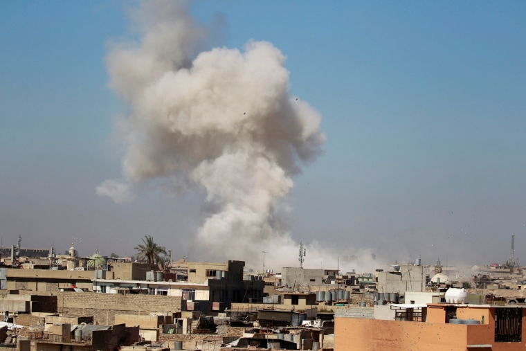 Image: Smoke rises over the city during clashes between Iraqi forces and Islamic State militants, in Mosul