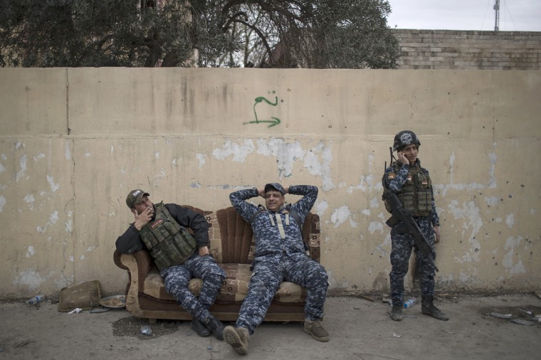 Image: Federal Police officers rest on a couch during fighting between Iraqi security forces and Islamic State militants, on the western side of Mosul, March 19.
