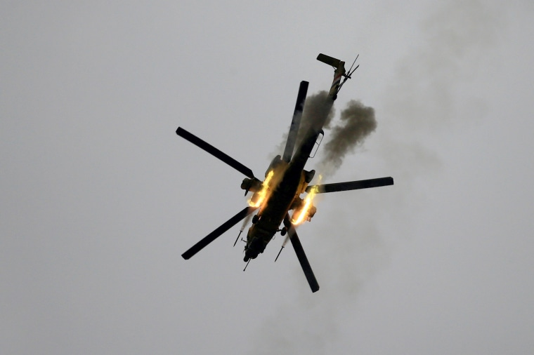 Image: An Iraqi Air Force helicopter fires missiles against Islamic State militants during a battle in Mosul, March 19.
