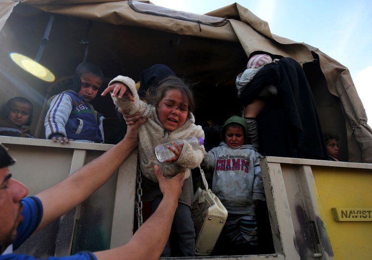 Image: Displaced Iraqis from Mosul arrive at the Hamam al-Alil camp on March 20, during the government forces ongoing offensive to retake the western parts of the city from Islamic State group fighters.