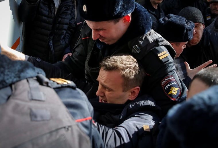 Image: Police officers detain anti-corruption campaigner and opposition figure Alexei Navalny during a rally in Moscow, Russia