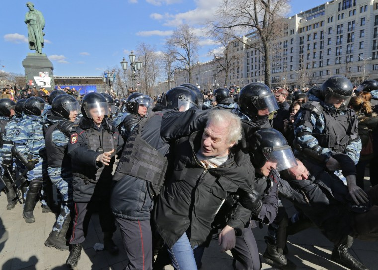Image: Russian riot policemen detain protesters during an opposition rally in central Moscow.
