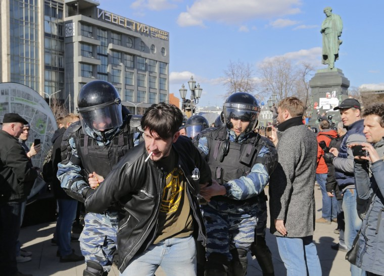 Image: Russian riot policemen detain protesters during an opposition rally.