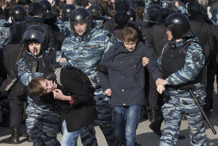 Image: Police detain protesters in downtown Moscow-- the biggest gathering in a wave of nationwide protests that were the most extensive show of defiance in years.